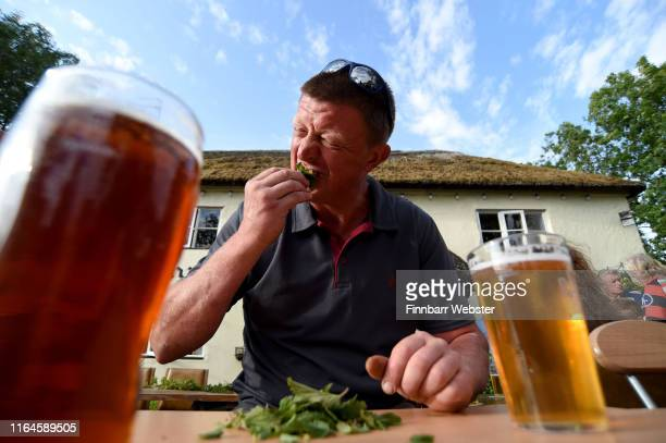 Competitors during the competition at The Bottle Inn on July 27 2019 in Marshwood England Competitors are served 2foot long stalks of stinging...