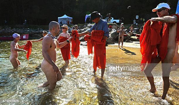 Competitors emerge from the water at the finish the second annual Sydney Skinny where they take part in an attempt to break the world record for the...