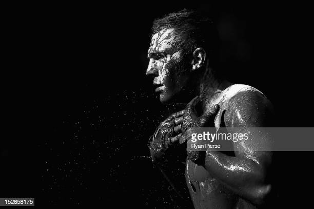 A competitors emerges from a mud pit during 2012 Tough Mudder at Glenworth Valley on September 23 2012 in Sydney Australia