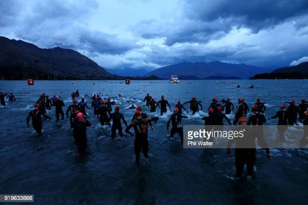 Competitors enter the lake for the start of the 2018 Challenge Wanaka on February 17 2018 in Wanaka New Zealand