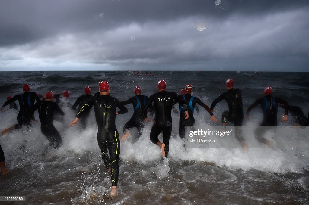 Competitors enter the water during the swim stage of Challenge Melbourne on February 1, 2015 in Melbourne, Australia.