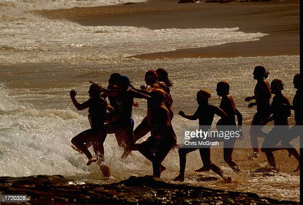 Competitors enter the water for the start of the Womens Qualifying final during the Open Iron Woman qualifying round prior to the 2003 Kelloggs Nutri...