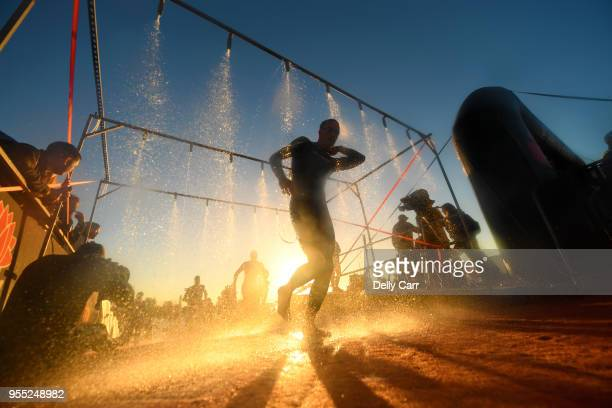 Competitors exit the 4km swim during Ironman Australia on May 6 2018 in Port Macquarie Australia Photo by Delly Carr/Getty Images