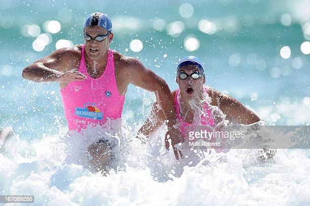 Competitors exit the water in the Open Men's Surf Race during the 2013 Australian National Surf Lifesaving Titles on April 20 2013 on the Gold Coast...