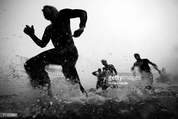 Competitors exit the water to the transition area at the end of the swim leg the Escape from Alcatraz Triathlon on June 4 2006 in San Francisco...