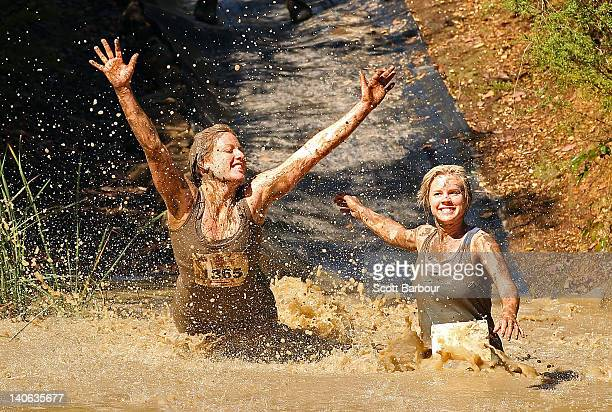 Competitors fall into muddy water as they compete in The Tough Bloke Challenge on March 4 2012 in Melbourne Australia The Tough Bloke Challenge is...