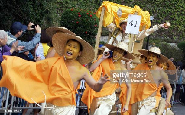 Competitors from Buddhist Youth Association Ltd dress up in various costumes at Sedan Chair Race Bazaar 2013 at The Peak organised by Sedan Chair...