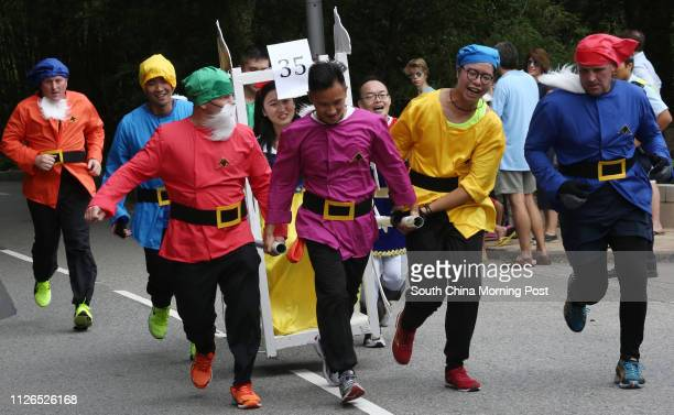 Competitors from Matilda International Hospital dress up in various costumes at Sedan Chair Race and Bazaar 2014 at The Peak organised by Sedan Chair...