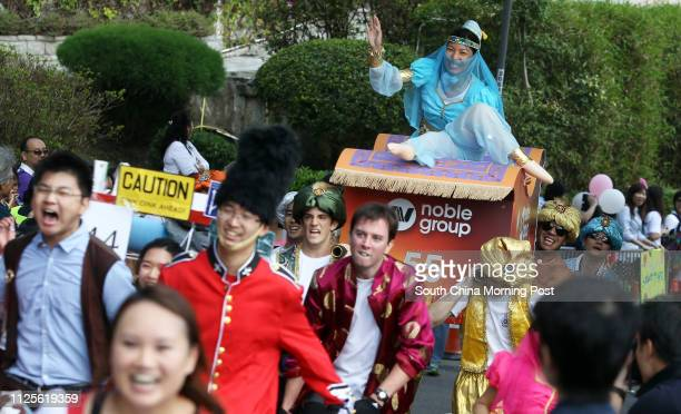 Competitors from Noble Group dress up in various costumes at Sedan Chair Race Bazaar 2013 at The Peak organised by Sedan Chair Charities Fund 27OCT13