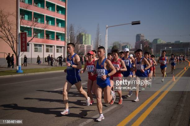 Competitors from North Korea run along a road during the annual 'Mangyongdae Prize International Marathon' in Pyongyang on April 7 2019 Twice as many...