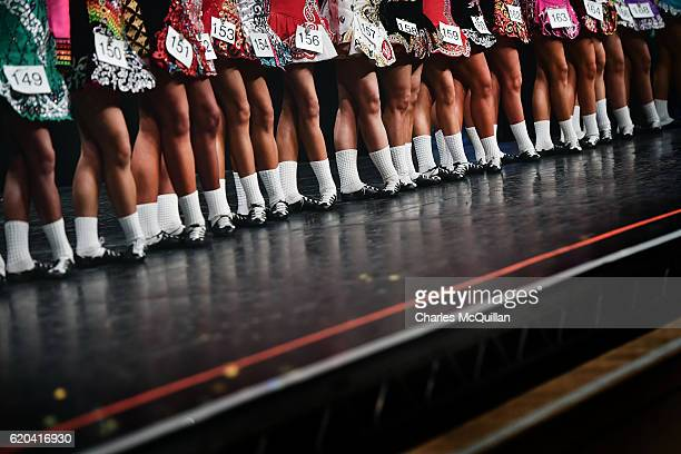 Competitors gather on stage as they take part in the All Ireland Irish Dancing Championships on November 2 2016 in Belfast Northern Ireland The...