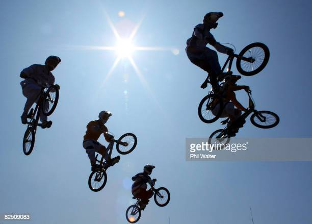 Competitors get air during the Men's BMX final run held at the Laoshan Bicycle Moto Cross Venue during Day 14 of the Beijing 2008 Olympic Games on...
