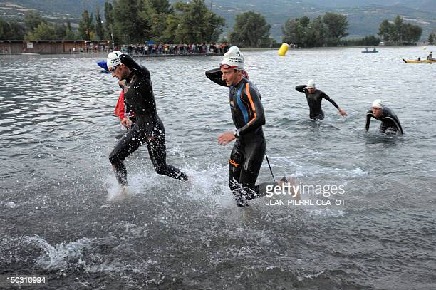 Competitors get out of the water during the 27th edition of the Embrunman triathlon on August 15 2010 in Embrun southeastern France The Embrunman is...
