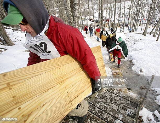 Competitors haul their toboggans to top of the chute during qualifying at the 20th annual US National Toboggan Championships at the Camden Snow Bowl...