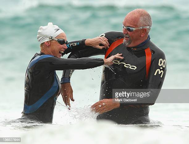 Competitors have a friendly argument as they walk out of the water during the 2012 Pier to Pub on January 7 2012 in Lorne Australia