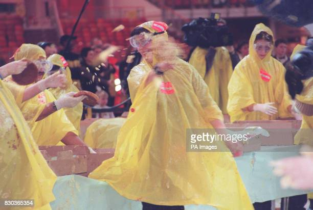 Competitors having a fling whilst taking part in the world's biggest custard pie fight held at The Millennium Dome in south London