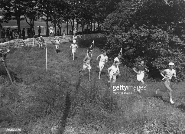 Competitors having just passed the Rue Paul Bert during the men's cross country event at the 1924 Summer Olympics, around Colombes near Paris,...