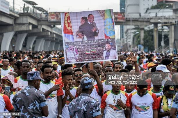 Competitors hold a banner with images of leaders as they gather to run the first EthiopiaEritrea Peace and reconciliation Run at Meskel Square in...