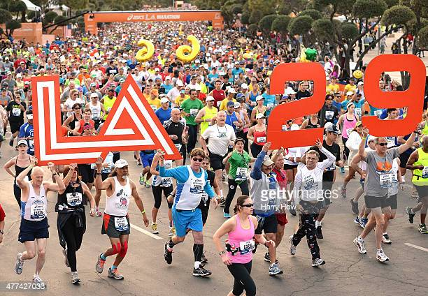 Competitors hold signs to indicate the 29th running at the start of the Los Angeles Marathon at Dodger Stadium on March 9 2014 in Los Angeles...