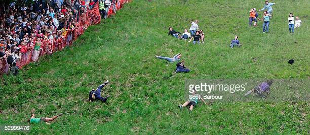 Competitors hurl themselves down a steep slope in pursuit of a double Gloucester cheese during the Gloucestershire 'Cheese Rolling and Wake' on May...