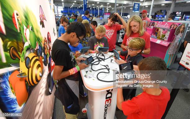 Competitors in the 12 and under division battle for the top score on NintendoÕs Mario Kart 7 at the Best Buy in Torrance on Saturday August 26 2017...
