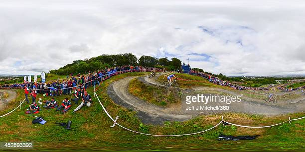 Competitors in the Cross Country Mountain Biking make their way round the Cathkin Braes Mountain Bike Trails track during day six of the Glasgow 2014...