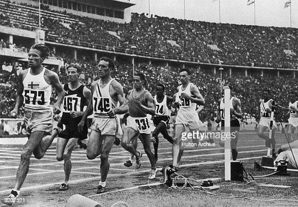 Competitors in the men's 1500 meter race run around the track at the Summer Olympic Games in Berlin Germany Jack Lovelock of New Zealand won the gold...