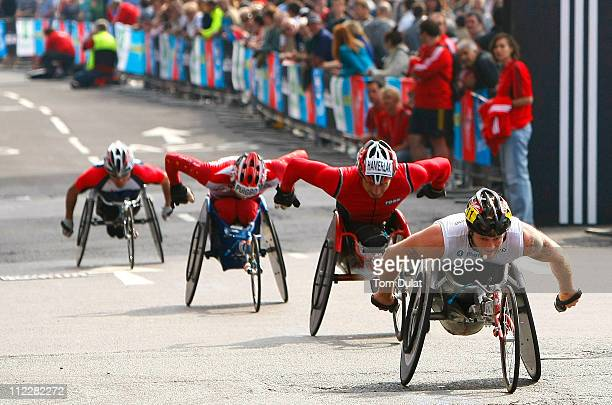 Competitors in the men's wheelchair race pass through Parliament Square in Westminster during the 2011 Virgin London Marathon on April 17 2011 in...