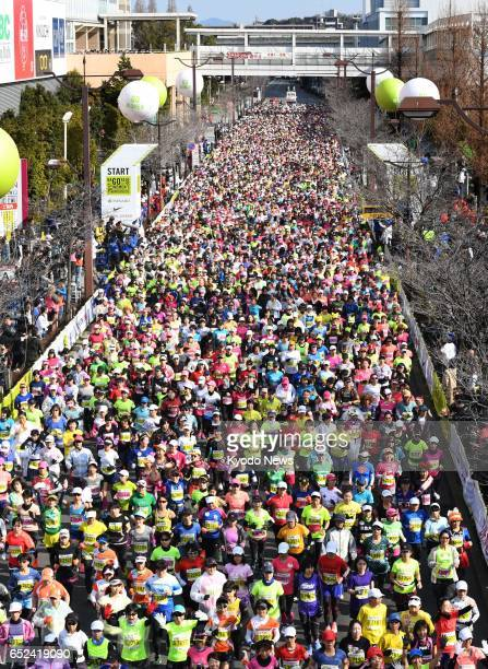 Competitors in the Nagoya Women's Marathon flood down a street in the central Japanese city of Nagoya on March 12 2017 ==Kyodo