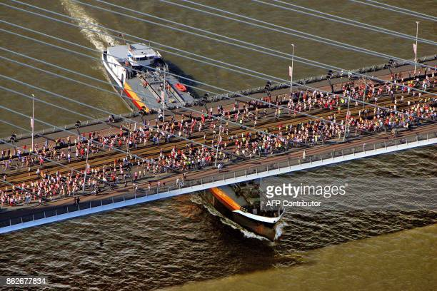 Competitors in the Rotterdam Marathon run across the Erasmus bridge 15 April 2007 at the start of the race near Rotterdam Kenya's Joshua Chelanga won...