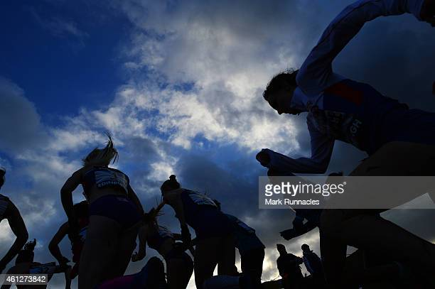 Competitors in the senior women's 6k race climb a hill during the Great Edinburgh X Country at Holyrood Park on January 10 2015 in Edinburgh Scotland