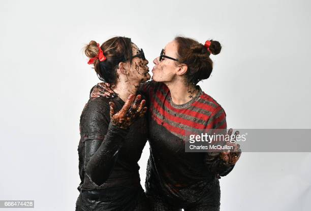 Competitors in the the annual McVities Mud Madness 8km cross country run pose for a portrait in a pop up photo booth on April 9, 2017 in Portadown,...