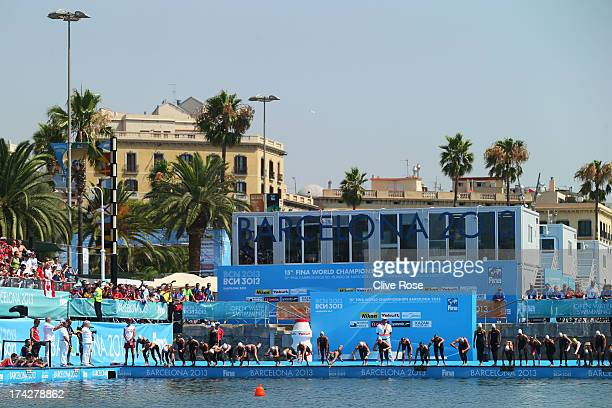 Competitors jump in the water at the start of the Open Water Swimming Women's 10k race on day four of the 15th FINA World Championships at Moll de la...