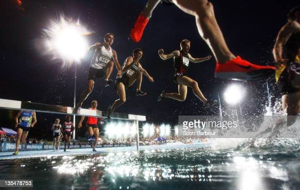 Competitors jump into the water during the Malinowski Mens 3000m Steeple during the 2011 Zatopek Classic at the Victorian Athletics Centre on...