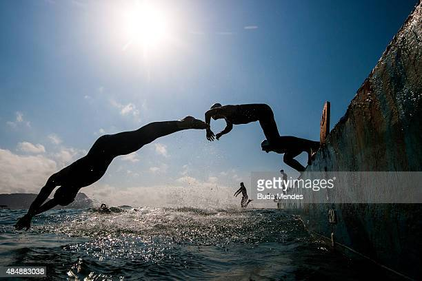 Competitors jump into the waters of Copacabana beach as they take part in the Marathon Swimming Challenge Aquece Rio Test Event for Rio 2016 Olympics...
