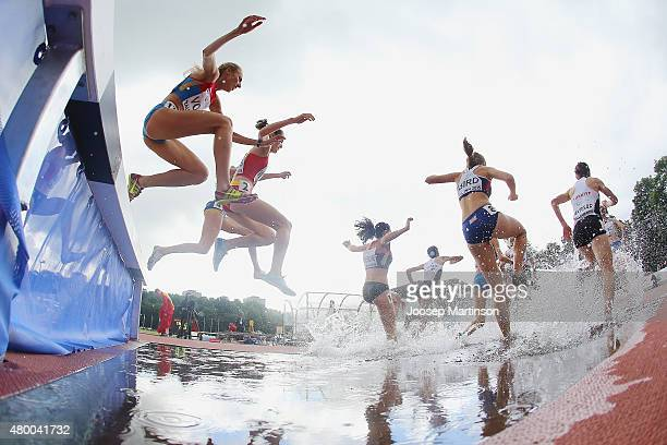 Competitors jump over the water barrier during Women's 3000m Steeplechase qualification on day one of the European Athletics U23 Championships at...