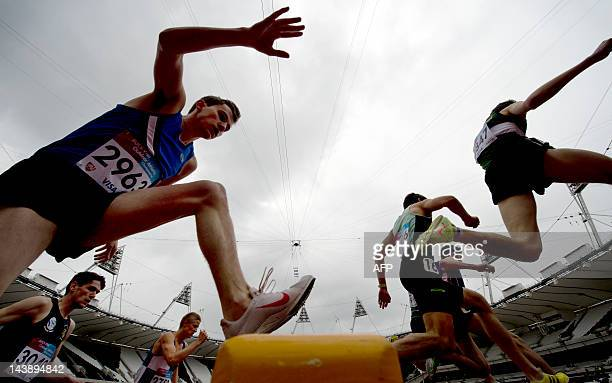 Competitors jump the water hurdle during the Men's 3000 metres steeplechase during the British Universities and Colleges Sport Athletics...