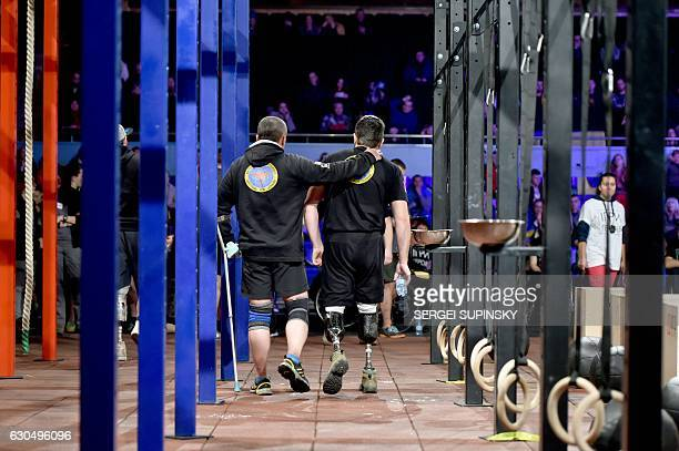Competitors leave after the final competition of the 'Games of the Heroes' crossfit challenge in Kiev on December 24 2016 Some fifteen Ukrainian...
