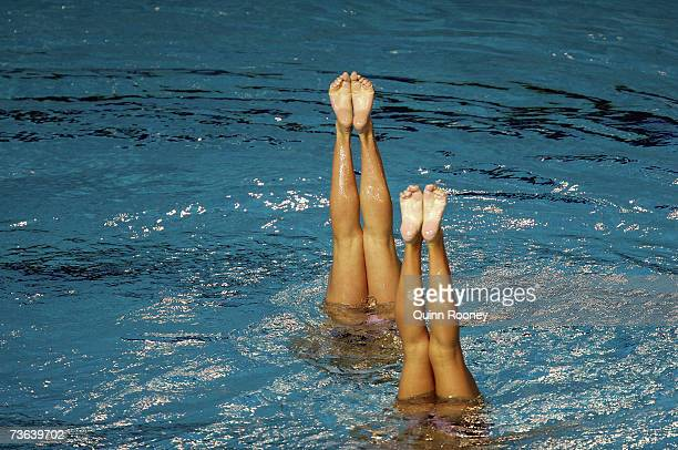 Competitors legs are seen during the Duet Technical final at the synchronized swimming event during the XII FINA World Championships at the Rod Laver...