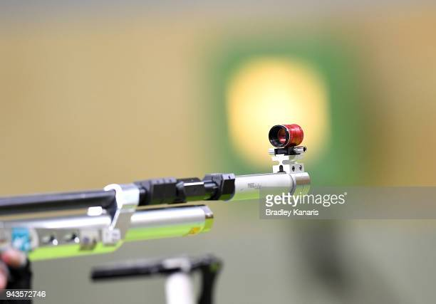 Competitors line up to the target as they prepare to shoot in the final of the Women's 10m Air Rifle event during Shooting on day five of the Gold...