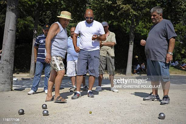 Competitors look at their boules after playing on July 3 2011 at the Borely park in Marseille southern France during the 50th world championship...