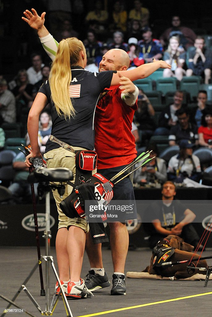 Competitors Luc Martin (CAN) and Chasity Kuczer (USA) hug after the Archery Finals at the Invictus Games at ESPN Wide World of Sports complex on May 9, 2016 in Lake Buena Vista, Florida.