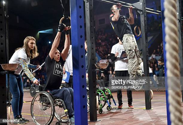 Competitors make exercises as they take part in the final competition for CrossFit Gmes called 'Games of the Heroes' in Kiev on December 24 2016 Some...