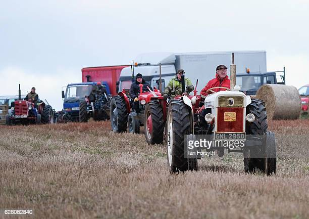 Competitors make their way across the fields ahead of the annual ploughing match on November 27, 2016 in Staithes, United Kingdom. The event which is...