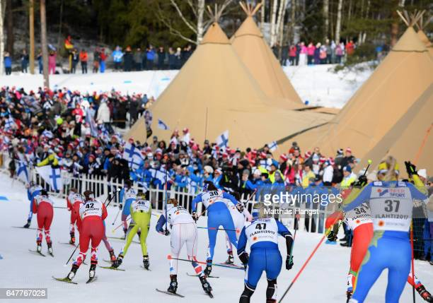 Competitors make their way around the course in the Women's Cross Country Mass Start during the FIS Nordic World Ski Championships on March 4, 2017...