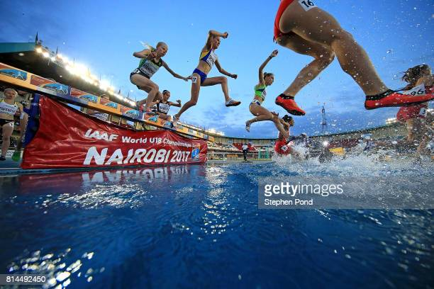 Competitors make their way over the water jump during the final of the women's 2000m steeplechase on day three of the IAAF U18 World Championships at...