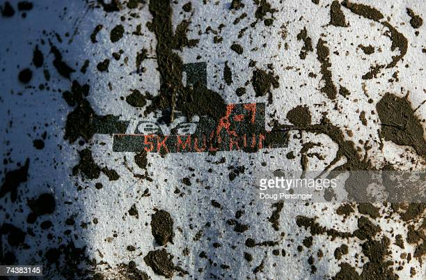 A competitors mud splattered tshirt shows the hazards of running in the Teva X1 5K Mud Fun Run at the Teva Mountain Games on June 2 2007 in Vail...