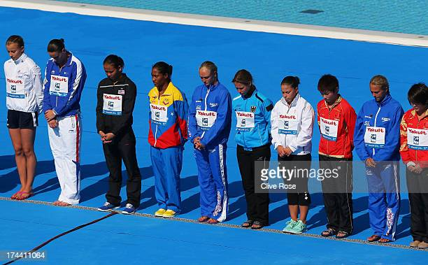 Competitors observe a minutes silence in honour of the Galicia rail derailment that killed 78 on Wednesday ahead of the Women's 10m Platform Diving...