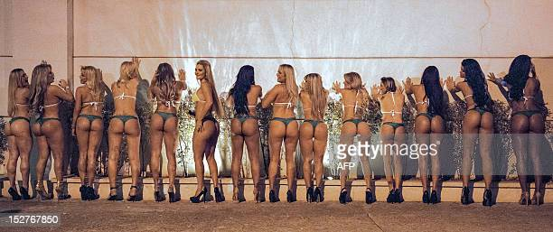 Competitors of Miss Bumbum Brasil 2012 the contest for the cutest bottom pose against a wall for local photographers before recording a TV program in...