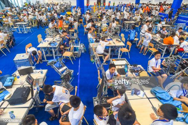 Competitors of robot teams adjust their robots during the 18th China Adolescent Robotics Competition World Adolescent Robot Contest 2018 on July 21...